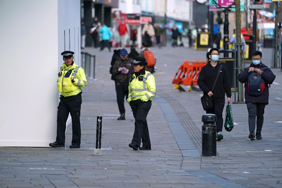 Police officers in Newcastle city centre at the start of a four week national lockdown for England.