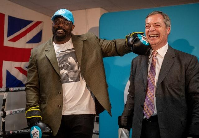 Heavyweight boxer Dereck Chisora with Brexit Party leader Nigel Farage at the Gator ABC Boxing Club in Hainault, Ilford, Essex