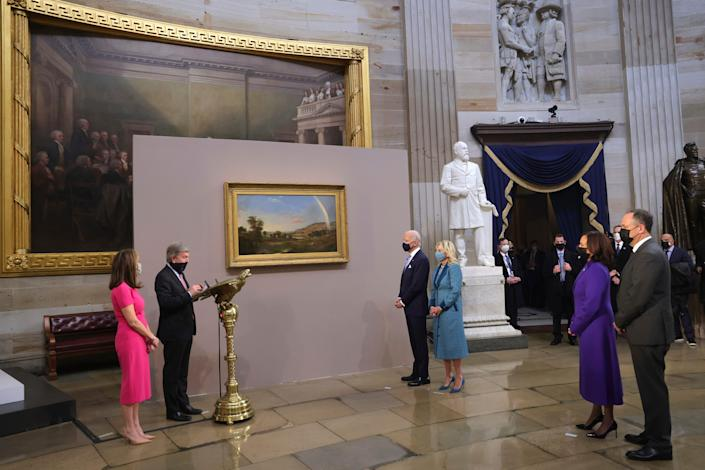 Sen. Roy Blunt, R-Mo, presents a painting to President Joe Biden and first lady Jill Biden, as Vice President Kamala Harris and Doug Emhoff look on at the presentation of gifts ceremony after the 59th Presidential Inauguration at the U.S. Capitol in Washington, Jan. 20, 2021.