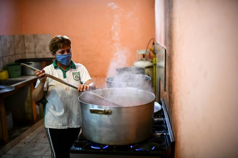 A woman cooking in a soup kitchen in the Puerta de Hierro slum in La Matanza, Argentina -- soup kitchens are common in this department on the outskirts of Buenos Aires