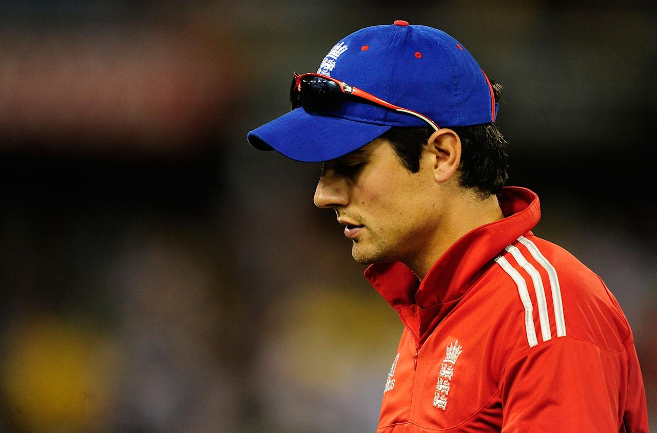 BRISBANE, AUSTRALIA - JANUARY 17:  Alastair Cook of England looks dejected after losing the second game of the One Day International Series between Australia and England at The Gabba on January 17, 2014 in Brisbane, Australia.  (Photo by Ian Hitchcock/Getty Images)