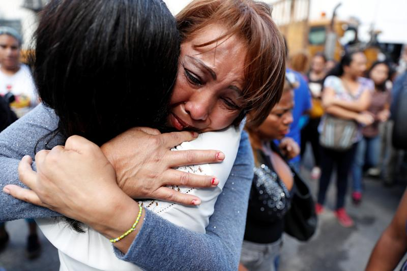 Relatives of inmates react outside a detention center of the Bolivarian National Intelligence Service (SEBIN), where a riot occurred, according to relatives, in Caracas