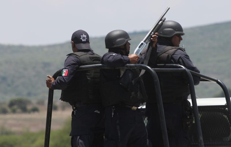 State police patrol in Michoacan state, a region that has been beset by drug violence and vigilante justice for years