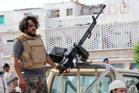 A fighter of the southern Yemeni separatists mans a machine gun mounted on a military vehicle securing an anti-government protest in Aden, Yemen January 28, 2018. REUTERS/Fawaz Salman
