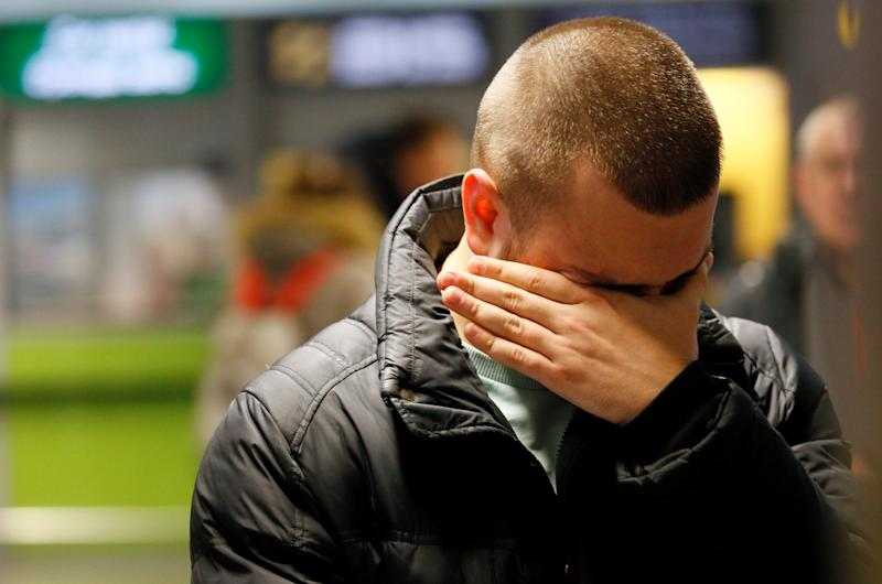A relative of a victim of the Ukraine International Airlines PS 752 plane that crashed after taking off from Tehran's Imam Khomeini airport reacts at Boryspil International Airport, outside Kiev, Ukraine January 8, 2020. REUTERS/Valentyn Ogirenko