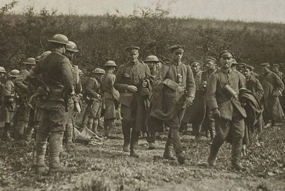 This photo provided by U.S. Army Heritage and Education Center has been cropped in to show a closer view of American soldiers with German prisoners in northern France during WWI on Sept. 26, 1918. The claim in Pennsylvania state Sen. Doug Mastriano's 2014 book about Sgt. York, that this U.S. Army Signal Corps photo was mislabeled and actually shows Alvin C. York with three German officers he captured, has been disputed by rival researchers. (U.S. Army's signal corps via AP)