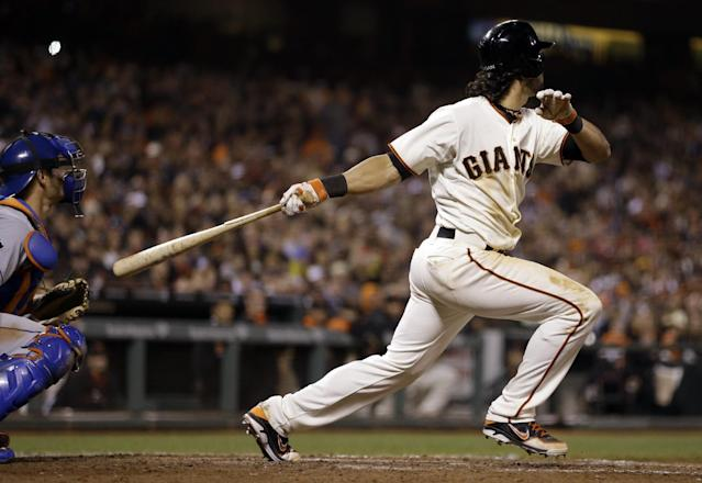 San Francisco Giants' Angel Pagan swings for a two run single off New York Mets' Bartolo Colon in the sixth inning of a baseball game Saturday, June 7, 2014, in San Francisco. (AP Photo/Ben Margot)