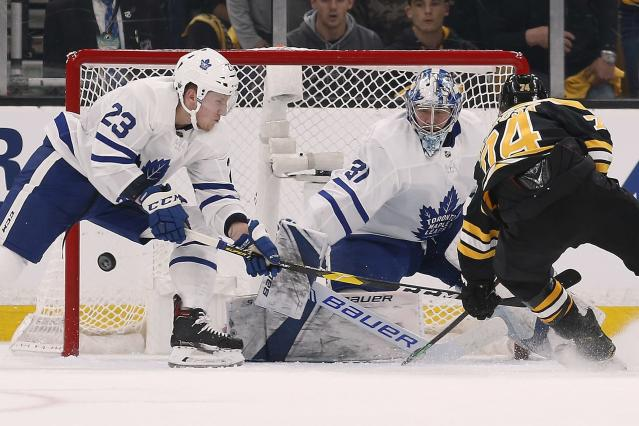Toronto Maple Leafs' Frederik Andersen (31) blocks a shot by Boston Bruins' Jake DeBrusk (74) during the first period in Game 5 of an NHL hockey first-round playoff series in Boston, Friday, April 19, 2019. (AP Photo/Michael Dwyer)