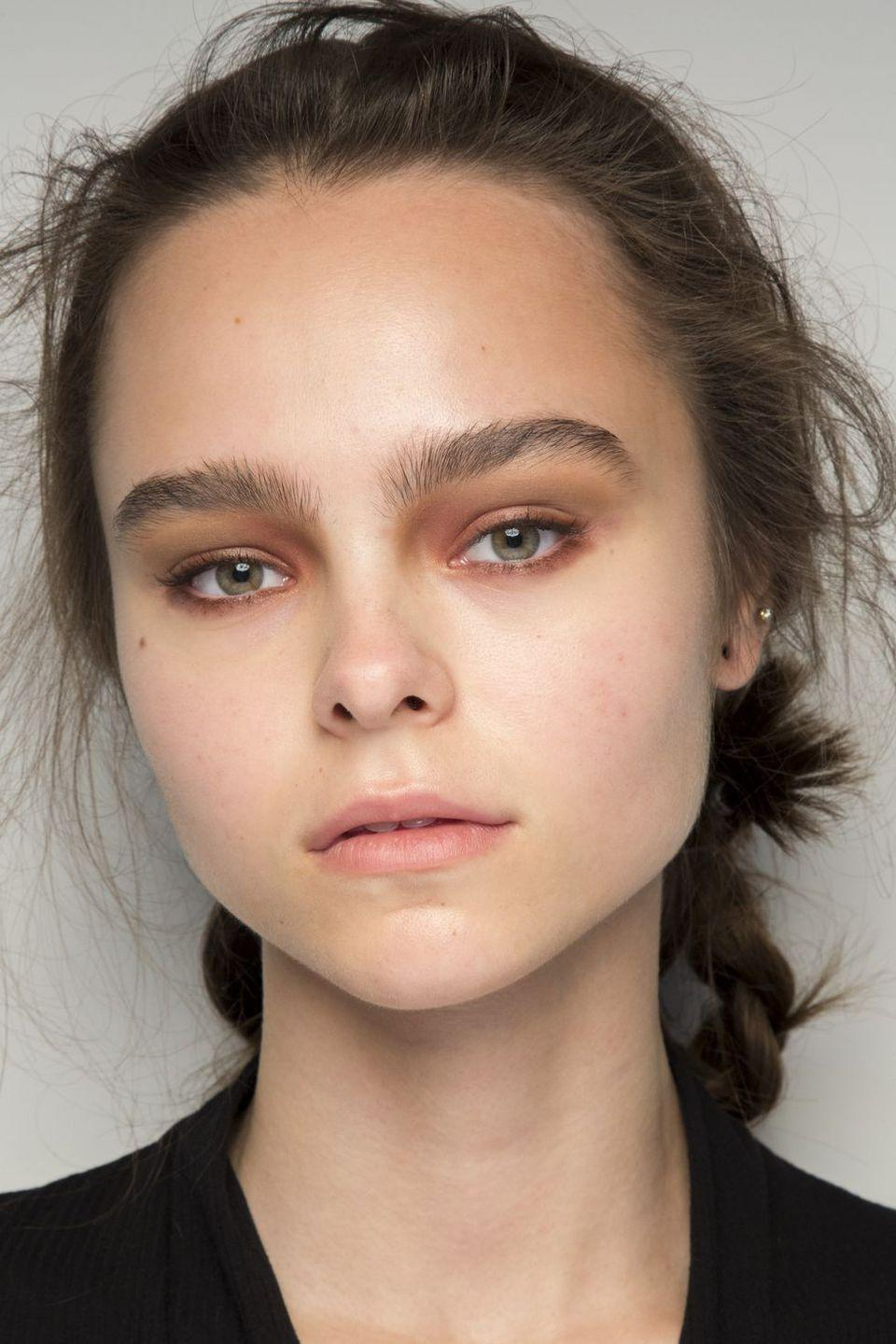 <p>A smoked-out taupe eye looks anything but basic backstage at Bora Aksu.</p>