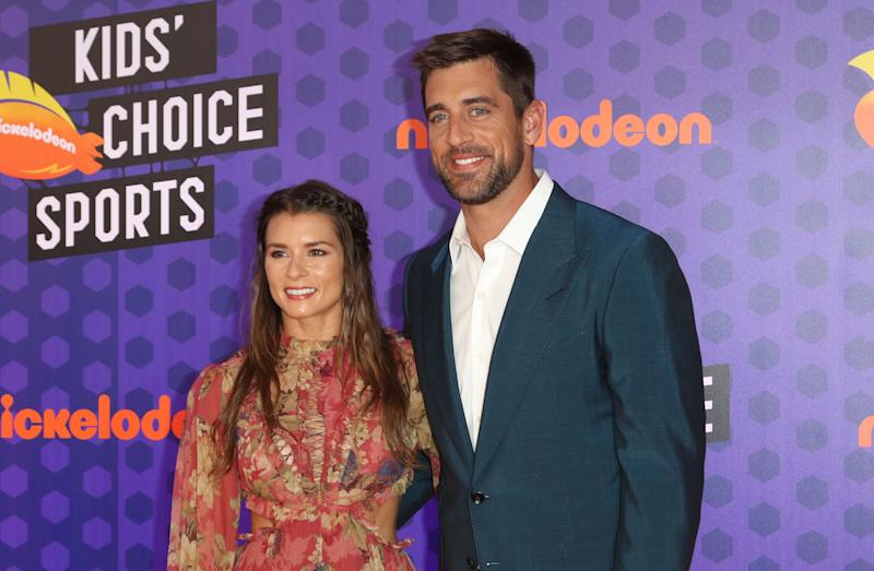 NFL football player Aaron Rodgers, of the Green Bay Packers, right, and Danica Patrick arrive at the Kids' Choice Sports Awards at the Barker Hangar on Thursday, July 19, 2018, in Santa Monica, Calif. (Photo by Willy Sanjuan/Invision/AP)