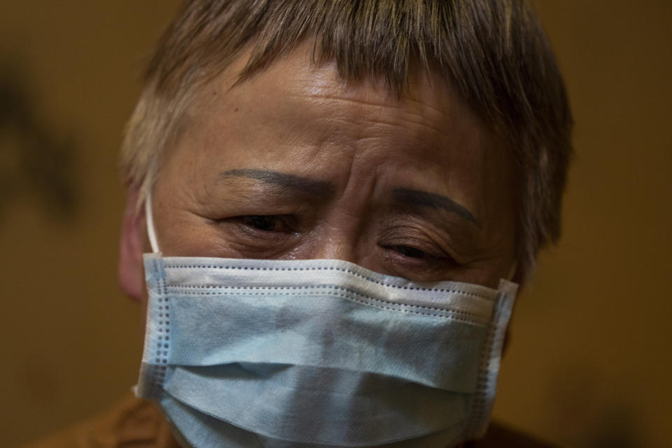 Zhong Hanneng talks about how her son, Peng Yi, had trouble getting tested for COVID-19 and eventually died from the disease, in Wuhan in central China's Hubei province on Saturday, Oct. 17, 2020. Widespread test shortages and problems at a time when the coronavirus arguably could have been curbed were caused largely by secrecy and cronyism at China's top disease control agency, an Associated Press investigation has found. (AP Photo/Ng Han Guan)