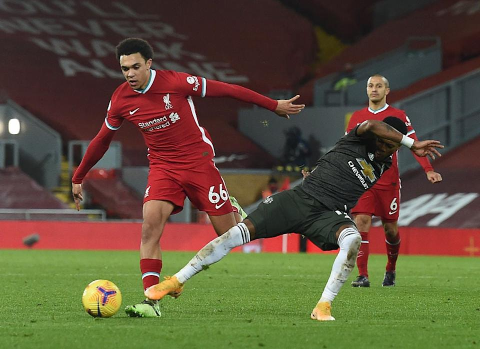 Trent Alexander-Arnold carries the ball under pressure (Getty)
