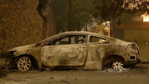 PHOTO: The remains of a car sits near the Fountaingrove Inn Hotel as it burns at rear in Santa Rosa, Calif., Oct. 9, 2017. (Jeff Chiu/AP)