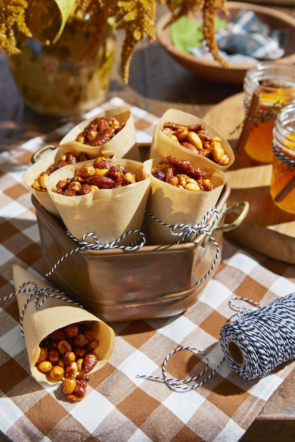 "<p>Crunchy chickpeas and sesame sticks, and a variety of spices like Aleppo pepper and lemon zest turn a handful of nuts into an irresistible snack. To keep it vegan swap the butter out for coconut oil or your <a href=""https://www.amazon.com/Earth-Balance-Buttery-Non-GMO-Verified/dp/B00B04NK2A/?tag=syn-yahoo-20&ascsubtag=%5Bartid%7C10050.g.35120802%5Bsrc%7Cyahoo-us"" rel=""nofollow noopener"" target=""_blank"" data-ylk=""slk:favorite butter alternative"" class=""link rapid-noclick-resp"">favorite butter alternative</a>, and use maple syrup in place of the honey.</p><p><strong><a href=""https://www.countryliving.com/food-drinks/a34945277/spicy-n-sweet-snack-mix-recipe/"" rel=""nofollow noopener"" target=""_blank"" data-ylk=""slk:Get the recipe"" class=""link rapid-noclick-resp"">Get the recipe</a>.</strong></p><p><a class=""link rapid-noclick-resp"" href=""https://www.amazon.com/Nordic-Ware-Natural-Aluminum-Commercial/dp/B0049C2S32/?tag=syn-yahoo-20&ascsubtag=%5Bartid%7C10050.g.35120802%5Bsrc%7Cyahoo-us"" rel=""nofollow noopener"" target=""_blank"" data-ylk=""slk:SHOP BAKING SHEETS"">SHOP BAKING SHEETS</a></p>"