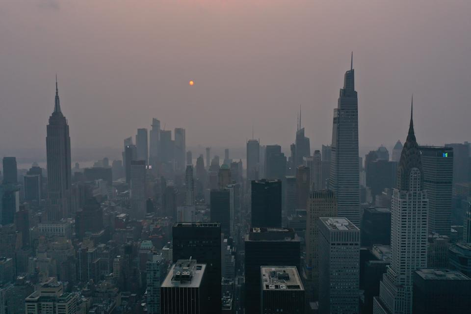 Wildfires burning out of control across the Western U.S. and Canada causes hazy skies throughout NYC and Washington DC July 20, 2021, in New York. Climate is a key factor in ESG investing. (Photo by Lokman Vural Elibol/Anadolu Agency via Getty)