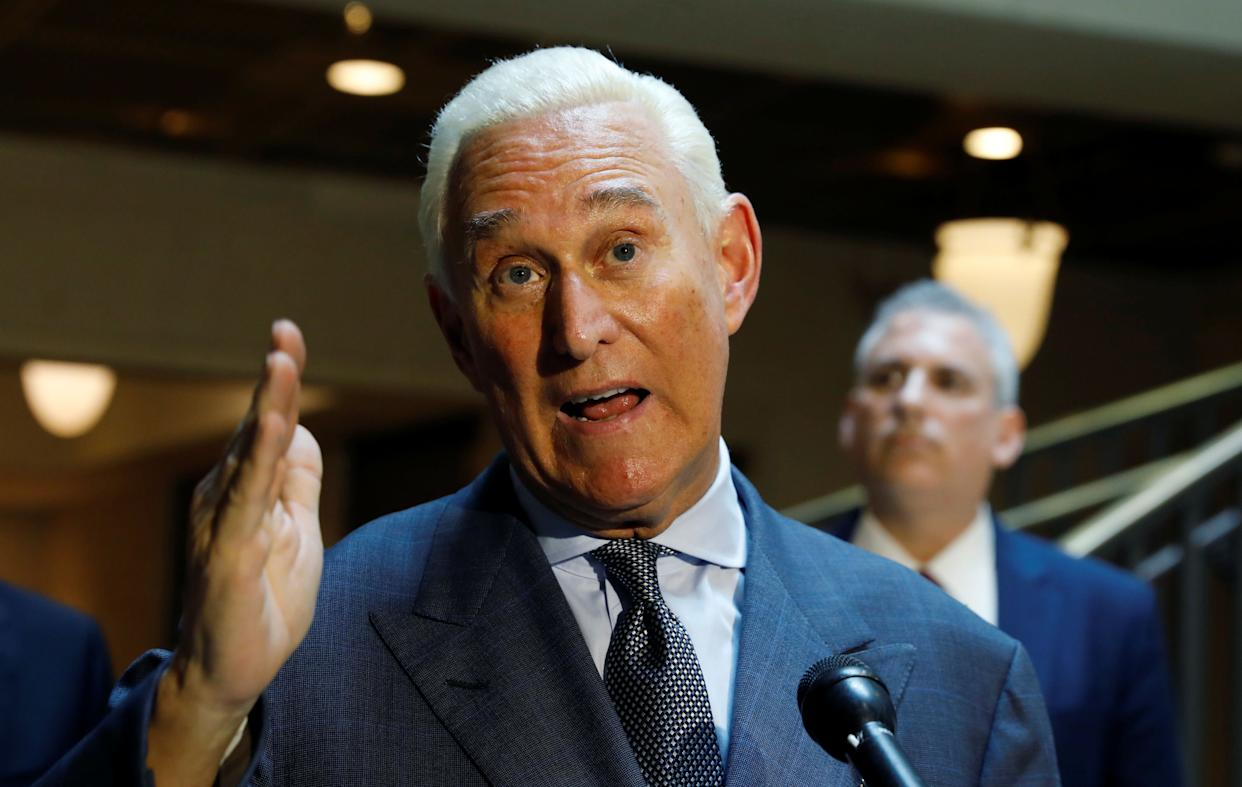 Roger Stone talks to reporters last year after testifying before the House Intelligence Committee. (Photo: Reuters/Kevin Lamarque)
