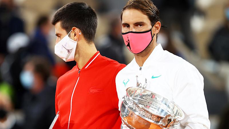Rafael Nadal and Novak Djokovic are pictured after the French Open final in 2020.