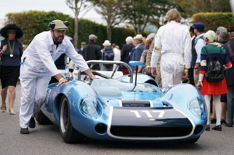A Lola-Chevrolet T70 Spyder is pushed towards the assembly area (Andrew Matthews/PA) (PA Wire)