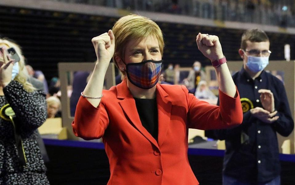Scottish First Minister Nicola Sturgeon reacts as she visits a counting centre as votes are counted for the Scottish Parliamentary election, in Glasgow, Scotland, Britain, May 7, 2021. - Russell Cheyne/REUTERS