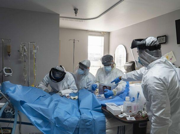PHOTO: Doctors and nurses wearing protective gear treat a patient in the Covid-19 intensive care unit (ICU) at the United Memorial Medical Center (UMMC) in Houston, Texas on June 29, 2020. (Go Nakamura/Bloomberg via Getty Images)