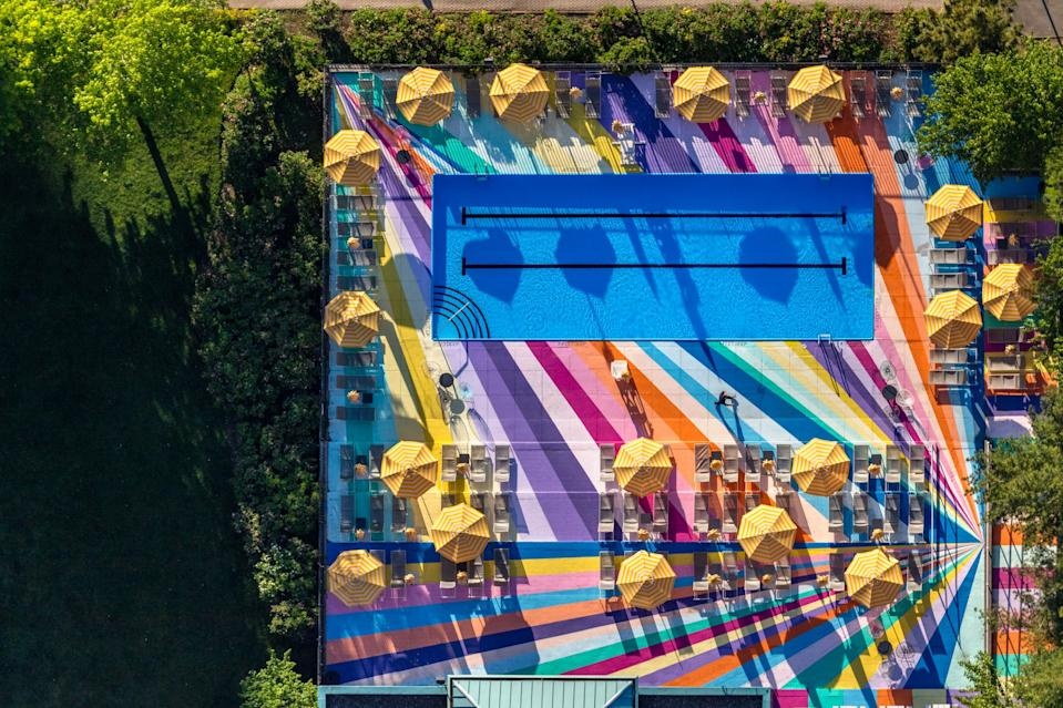 The artist used 18 colors to create a pattern that really makes the pool stand out in a city full of activity.