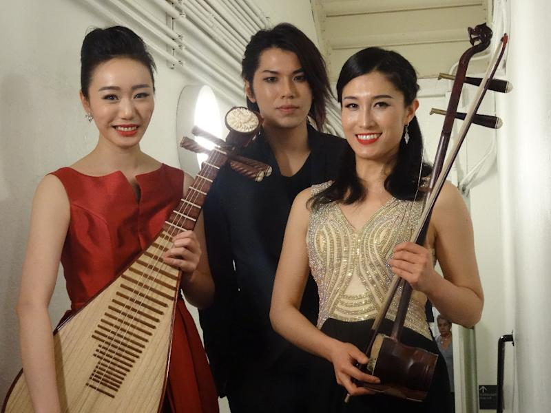 Chinese-born, New York-based artists exploring new musical frontiers, Pipa player Jiaju Shen (L), composer and pianist Li Zong (C) and huqin player Feifei Yang (R)