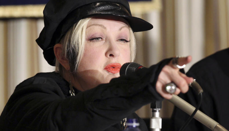 """Cyndi Lauper speaks during a press conference on her experience with the March 11 earthquake and tsunami at the Foreign Correspondents' Club of Japan in Tokyo Monday, March 12, 2012. Lauper, who is admired here as a true star who didn't run away despite the tsunami and nuclear crisis last year, is back, to show that she hasn't forgotten. """"It's a big tragedy but everybody is trying to move forward. I just want to say hey don't forget about Japan,"""" Lauper told a news conference in Tokyo. (AP Photo/Junji Kurokawa)"""