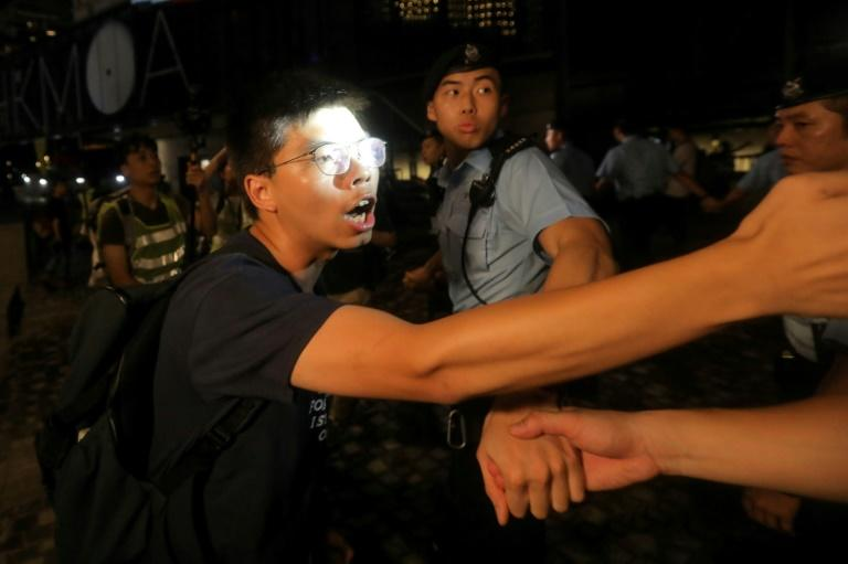 Wong confronted police after a rally in West Kowloon (AFP Photo/VIVEK PRAKASH)