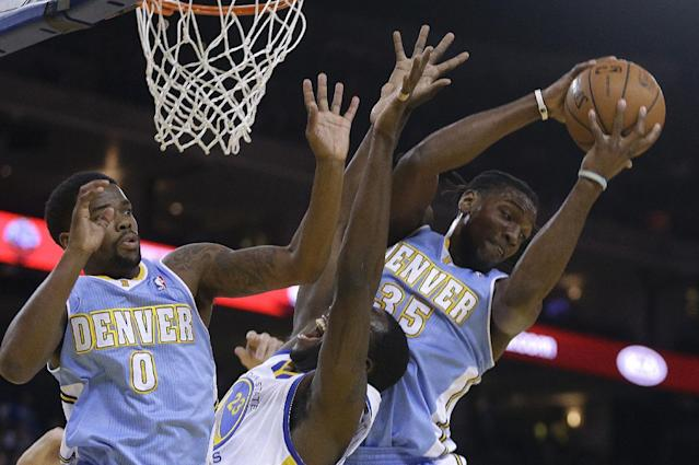 Denver Nuggets' Kenneth Faried, right, rebounds the ball over Golden State Warriors' Draymond Green (23) during the first half of an NBA basketball game Thursday, April 10, 2014, in Oakland, Calif. At left is Nuggets' Aaron Brooks. (AP Photo/Ben Margot)