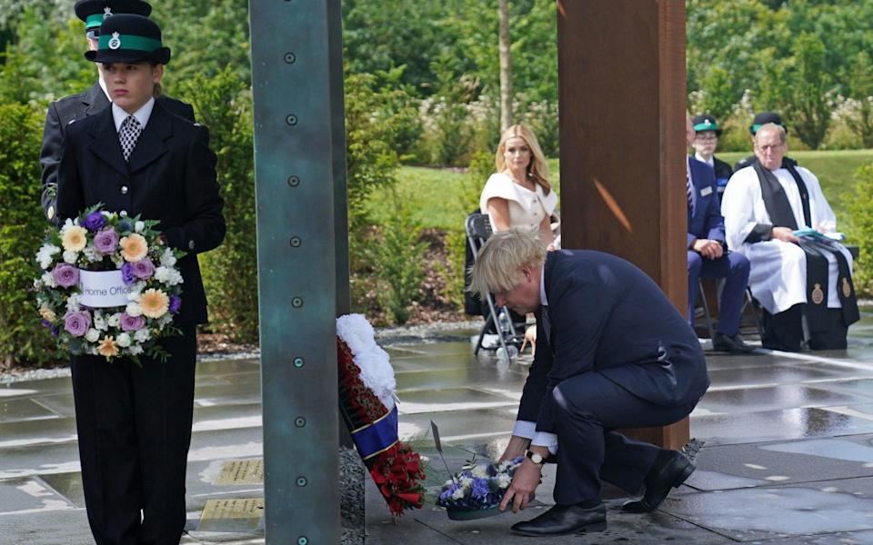 Boris Johnson lays a wreath at the site to commemorate those who have given their lives in service - Jacob King/PA