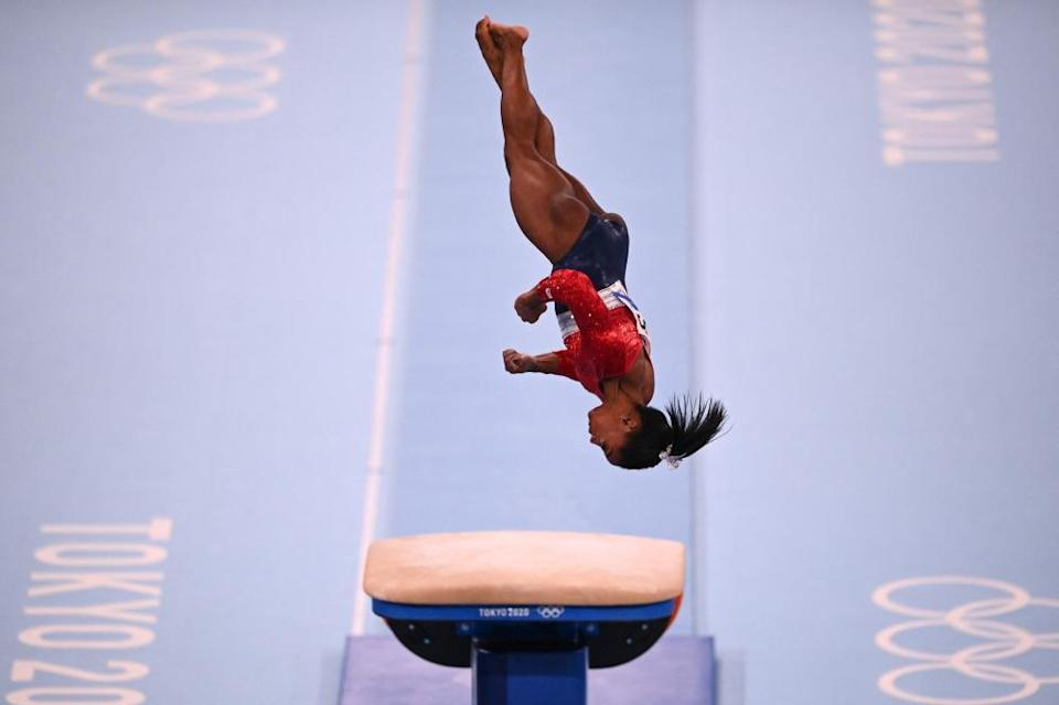 Simone Biles competes in the vault event of the artistic gymnastics women's team final.