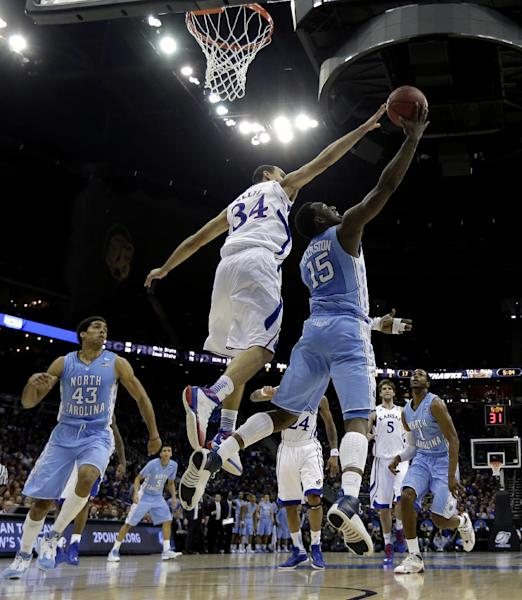 North Carolina guard P.J. Hairston (15) shoots under pressure from Kansas forward Perry Ellis (34) during the first half of a third-round game in the NCAA college basketball tournament Sunday, March 24, 2013, in Kansas City, Mo. (AP Photo/Charlie Riedel)