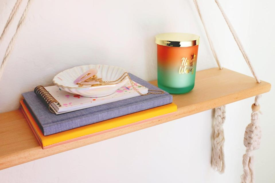 <p>Save space in a small bedroom by using a hanging shelf as your nightstand. Stack a journal and an agenda on one side and balance things out with a yummy-smelling candle on the other to set a peaceful mood. A trinket dish is perfect for holding your jewelry and hair accessories at the end of the day.</p>