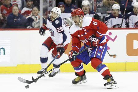 Jan 12, 2019; Washington, DC, USA; Washington Capitals left wing Alex Ovechkin (8) skates with the puck as Columbus Blue Jackets right wing Oliver Bjorkstrand (28) chases in the first period at Capital One Arena. Mandatory Credit: Geoff Burke-USA TODAY Sports