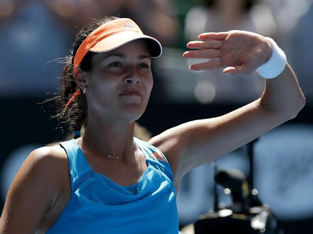 Ana Ivanovic of Serbia waves to the crowd as she celebrates her win over Serena Williams of the U.S. in their fourth round match at the Australian Open tennis championship in Melbourne, Australia, Sunday, Jan. 19, 2014.(AP Photo/Aaron Favila)