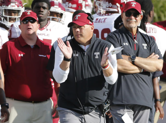 FILE - In this Sept. 2, 2017, file photo, Temple head coach Geoff Collins encourages his team during the second half of an NCAA college football game against Notre Dame, in South Bend, Ind. Georgia Tech has hired Temple coach Geoff Collins to replace Paul Johnson as the Yellow Jackets coach. Collins, a Conyers, Georgia native, is a former Florida and Mississippi State defensive coordinator who was 15-10 in two seasons at Temple. Georgia Tech announced the hire on Friday, Dec. 7, 2018, and planned a news conference for later in the day. (AP Photo/Charles Rex Arbogast, File)