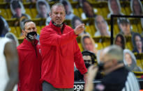Utah head coach Larry Krystkowiak, back, argues with referees in the second half of an NCAA college basketball game against Colorado, Saturday, Jan. 30, 2021, in Boulder, Colo. (AP Photo/David Zalubowski)