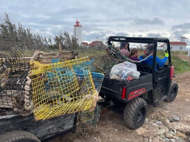 Environmental group Verts Rivages said they managed to collect about 8,200 pounds of trash including 123 lobster traps near the Miscou lighthouse. (Submitted by Lisa Fauteux - image credit)