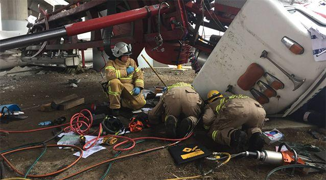 Fire crews worked to free the driver. Source: Facebook / MFB / Commander Rick Gili