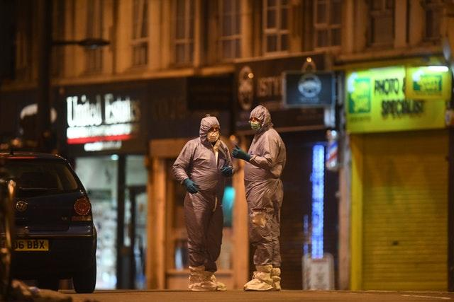 Police forensic officers works at the scene in Streatham High Road, south London