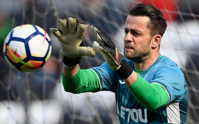 "West Ham United have announced the signing of Poland goalkeeper Lukasz Fabianski from Swansea City. Fabianski, 33, joins West Ham on a three-year deal for an undisclosed fee following the Welsh club's relegation from the Premier League. ""West Ham is a massive club so I'm really happy to be joining at such an exciting time here,"" said former Arsenal goalkeeper on the West Ham website. ""I will do my best on and off the pitch to help the team to achieve the best results possible and can't wait to start this new chapter of my career."" His transfer follows the club-record signing of defender Issa Diop from Toulouse for a club-record fee, reported to be £22 million, and full-back Ryan Fredericks from Fulham. Premier League club-by-club review Fabianski, who is currently at the World Cup with Poland, looks set to compete with Spaniard Adrian as new West Ham manager Manuel Pellegrini reshapes his squad. West Ham director of football Mario Husillos said: ""Lukasz is an experienced and established Premier League goalkeeper, with great quality that he has shown at both domestic and international level. ""He fits perfectly the mould of the modern goalkeeper, with excellent agility, presence and distribution, and will bring strong competition to the position."""