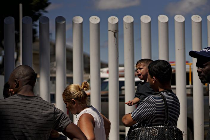 <p>Undocumented migrants wait for asylum hearings outside of the port of entry in Tijuana, Mexico on Monday, June 18, 2018. The Trump administration will no longer accept victims of domestic abuse or gang violence seeking asylum. (Photo: Sandy Huffaker/Getty Images) </p>