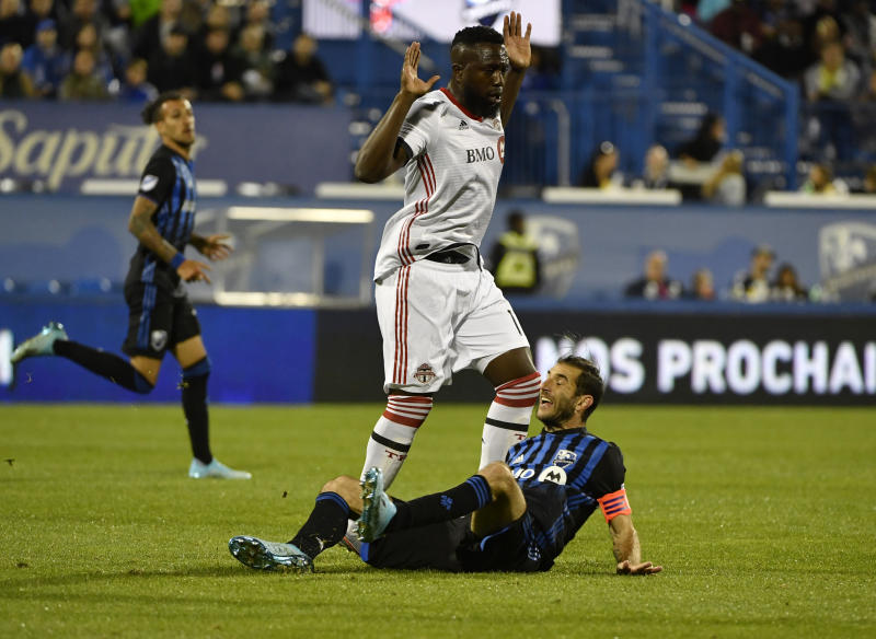 Sep 18, 2019; Montreal, Quebec, Canada; Montreal Impact midfielder Ignacio Piatti (10) collides with Toronto FC forward Jozy Altidore (17) during the second half in the Canadian Championship final at Stade Saputo. Mandatory Credit: Eric Bolte-USA TODAY Sports