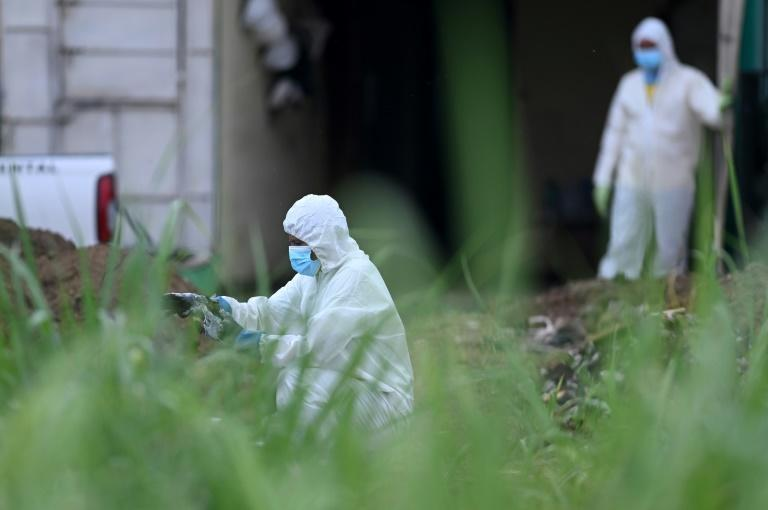 Authorities work at the home of former police officer Hugo Ernesto Osorio Chavez, suspcted of killing at least 14 people