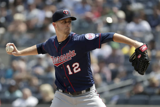 Minnesota Twins starting pitcher Jake Odorizzi throws a pitch to New York Yankees' Mike Tauchman during the third inning of a baseball game, Saturday, May 4, 2019, in New York. (AP Photo/Julio Cortez)
