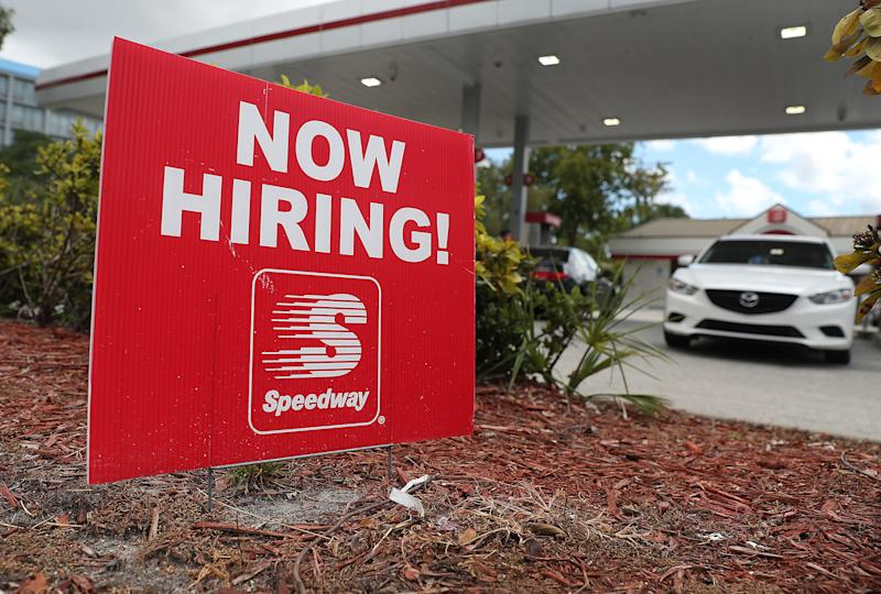 """MIAMI, FLORIDA - OCTOBER 04: A """"Now Hiring!"""" sign is seen in front of a Speedway gas station on October 04, 2019 in Miami, Florida. The economy added 136,000 new jobs in September, the government announced today. (Photo by Joe Raedle/Getty Images)"""