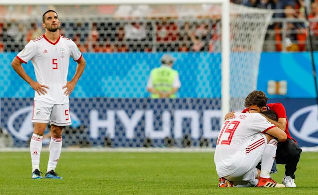 <p>Iran's Milad Mohammadi (L) and Majid Hosseini after their 2018 FIFA World Cup Group B football match against Portugal at Mordovia Arena Stadium. The game ended in a 1:1 draw. Mikhail Japaridze/TASS (Photo by Mikhail Japaridze\TASS via Getty Images) </p>