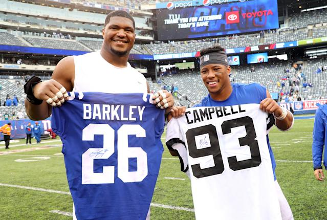 "<a class=""link rapid-noclick-resp"" href=""/nfl/players/8827/"" data-ylk=""slk:Calais Campbell"">Calais Campbell</a> and <a class=""link rapid-noclick-resp"" href=""/nfl/players/30972/"" data-ylk=""slk:Saquon Barkley"">Saquon Barkley</a> after swapping jerseys last Sunday. (Getty Images)"