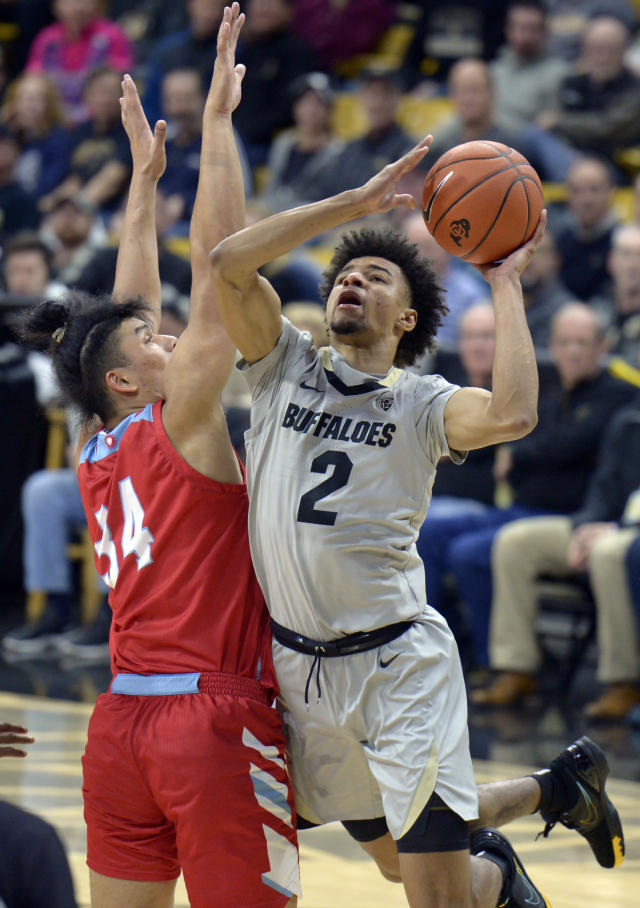 Colorado guard Daylen Kountz, right, is defended by Loyola Marymount forward Keli Leaupepe during the second half of an NCAA college basketball game Wednesday, Dec. 4, 2019, in Boulder, Colo. (AP Photo/Cliff Grassmick)