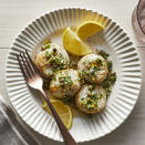 """<p>A quick and impressive dinner, scallops turn succulent and tender in the air fryer. The lemon-herb sauce is the perfect way to bring zest to each bite. Be sure to cook the scallops to temperature. They may not brown in the fryer, so don't wait for a golden crust to tell you they're ready. <a href=""""http://www.eatingwell.com/recipe/270221/air-fryer-scallops/"""" rel=""""nofollow noopener"""" target=""""_blank"""" data-ylk=""""slk:View recipe"""" class=""""link rapid-noclick-resp""""> View recipe </a></p>"""